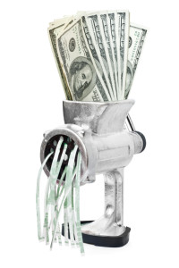 Money concept. Dollars are milled in meat grinder